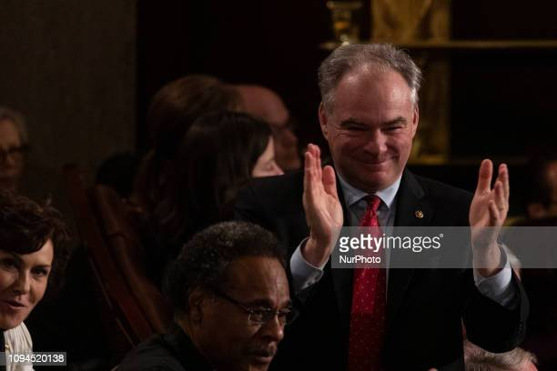 Sen Tim Kaine celebrates with fellow Democratic members in the House Chamber as President Donald Trump recognizes their achievement of electing a...