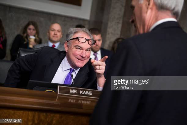 Sen Tim Kaine DVa talks with Secretary of the Navy Richard V Spencer before a Senate Armed Services Subcommittee on Readiness and Management Support...