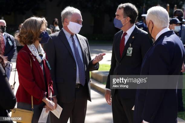 Sen. Tim Kaine talks to Virginia Governor Ralph Northam as Northam's wife Pamela Northam and U.S. House Majority Leader Rep. Steny Hoyer look on...