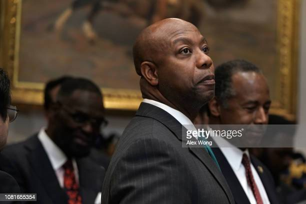 S Sen Tim Scott attends a signing event of an executive order to establish the White House Opportunity and Revitalization Council look on December 12...
