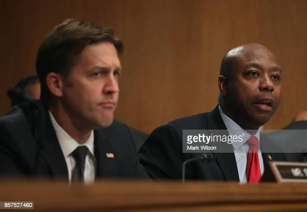 Sen Tim Scott questions former Equifax CEO Richard Smith while flanked by Sen Ben Sasse during a Senate Banking Housing and Urban Affairs Committee...