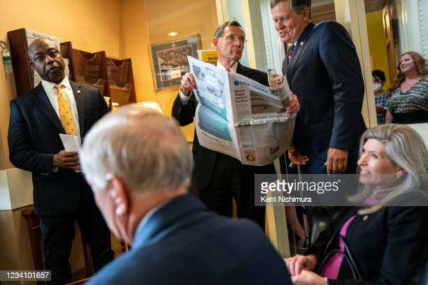 Sen. Tim Scott , Sen. Lindsey Graham , Sen. John Barrasso , Sen. Steve Daines and Sen. Joni Ernst talk with each other before a news conference on...