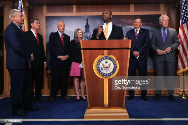 Sen. Tim Scott speaks to reporters during a news conference with Sen. Lindsey Graham , Sen. John Barrasso , Sen. Ron Johnson , Sen. Joni Ernst , Sen....