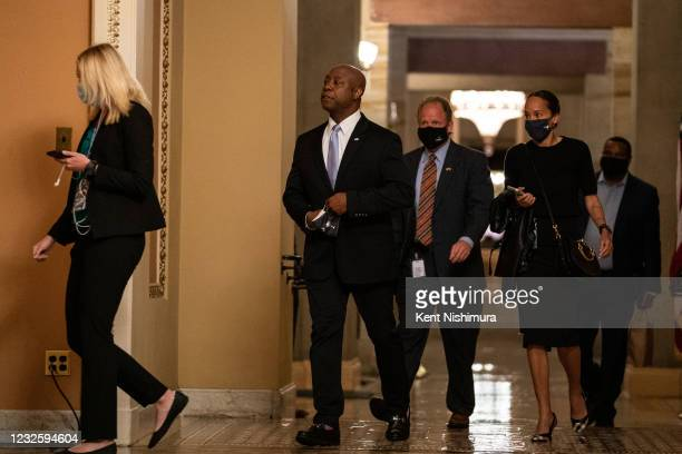 Sen. Tim Scott walks to deliver the opposition rebuttal to President Joe Bidens address of the Joint Session of the 117th Congress on the eve of the...