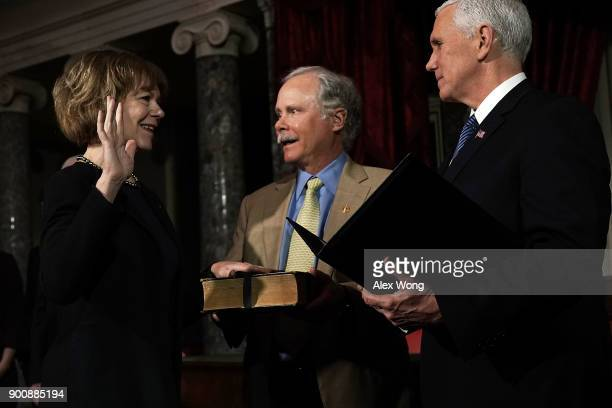 US Sen Tina Smith and her husband Archie Smith participate in a mock swearingin ceremony with Vice President Mike Pence at the Old Senate Chamber of...
