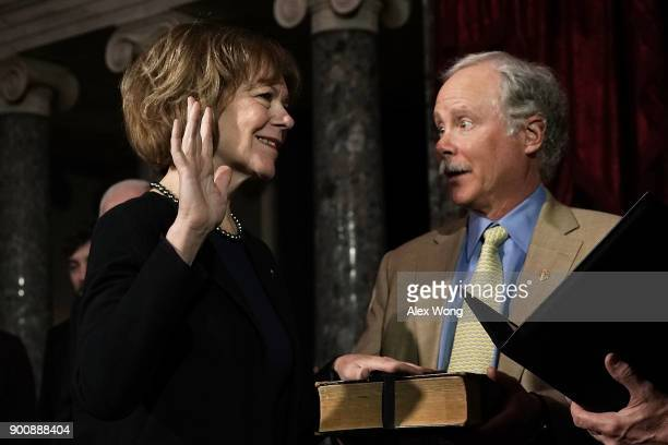 S Sen Tina Smith and her husband Archie Smith participate in a mock swearingin ceremony at the Old Senate Chamber of the US Capitol January 3 2018 in...