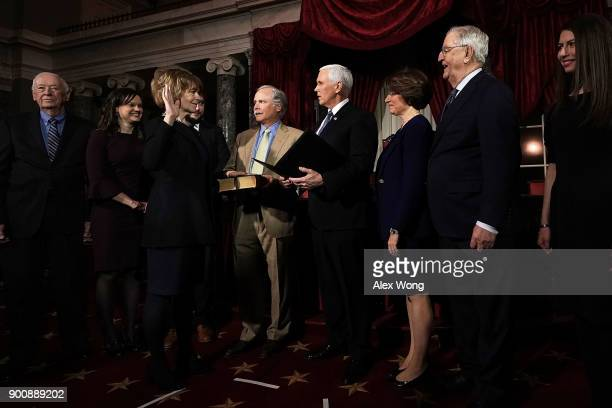 S Sen Tina Smith and her husband Archie Smith participate in a mock swearingin ceremony with Vice President Mike Pence as Sen Amy Klobuchar and...