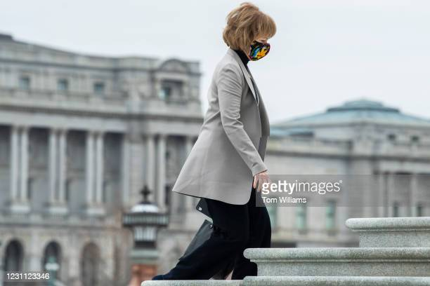 Sen. Tina Smith, D-Minn., arrives to the Capitol on the fourth day of former President Donald Trumps impeachment trial on Friday, February 12, 2021.