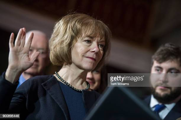 Sen Tina Smith DMinn is administered an oath by Vice President Mike Pence during a swearingin ceremony in the Capitol's Old Senate Chamber after the...