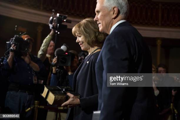 Sen Tina Smith DMinn is seen after being administered an oath by Vice President Mike Pence right during a swearingin ceremony in the Capitol's Old...