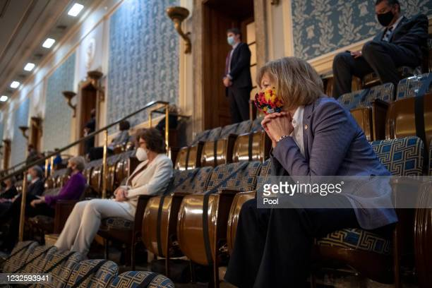 Sen. Tina Smith, D-Minn., watches President Joe Biden deliver his address to the joint session of Congress in the U.S. Capitol April 28, 2021 in...