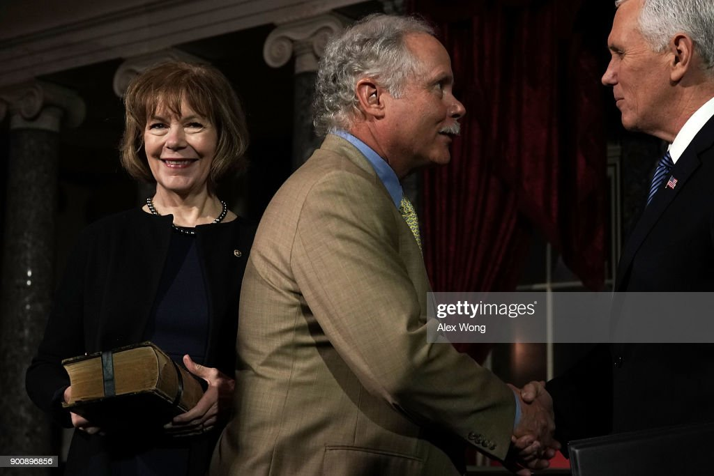 U.S. Sen. Tina Smith (D-MN) looks on as her husband Archie Smith greets Vice President Mike Pence during a mock swearing-in ceremony at the Old Senate Chamber of the U.S. Capitol January 3, 2018 in Washington, DC. Smith becomes the junior senator from Minnesota replacing Al Franken following sexual harassment allegations.