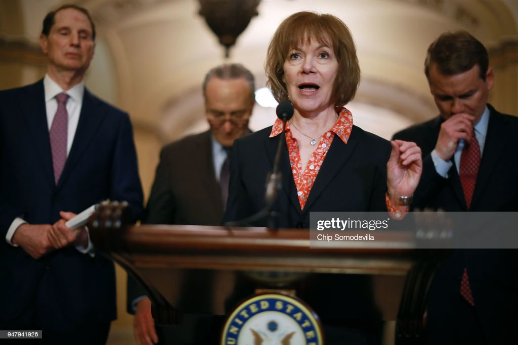 U.S. Sen. Tina Smith (D-MN) (C) talks with reporters as (L-R) Sen. Ron Wyden (D-OR), Senate Minority Leader Charles Schumer (D-NY) and Sen. Michael Bennet (D-CO) following the weekly Democratic policy luncheon at the U.S. Capitol April 17, 2018 in Washington, DC. Noting that Tuesday was Tax Day, the Democrats said the recent tax reform legislation penned by Republicans was mostly benefitting corporations and their shareholders.