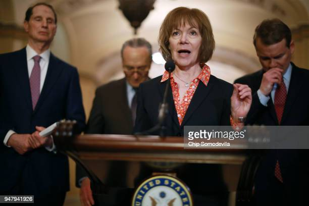 S Sen Tina Smith talks with reporters as Sen Ron Wyden Senate Minority Leader Charles Schumer and Sen Michael Bennet following the weekly Democratic...
