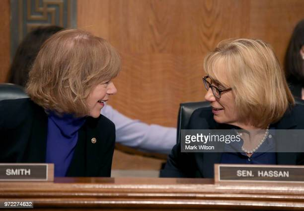 Sen Tina Smith talks with Sen Maggie Hassen during a Senate Health Education Labor and Pensions Committee hearing on Capitol Hill June 12 2018 in...