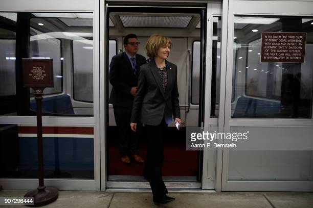 Sen Tina Smith walks to a Democratic Caucus meeting at the US Capitol January 19 2018 in Washington DC A continuing resolution to fund the government...