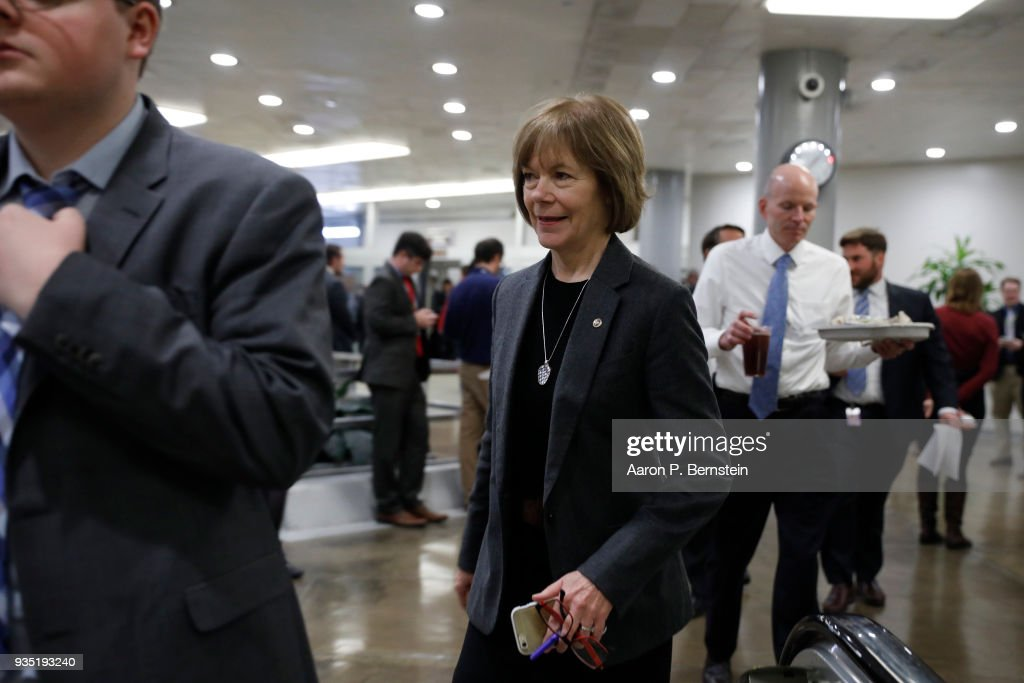 Sen. Tina Smith (D-MN) walks to the Capitol ahead of the weekly policy luncheons on Capitol Hill March 20, 2018 in Washington, DC. Congress faces a looming deadline to avoid another government shutdown.