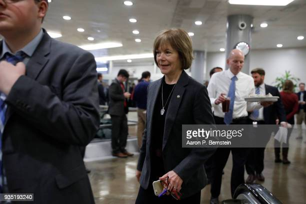 Sen Tina Smith walks to the Capitol ahead of the weekly policy luncheons on Capitol Hill March 20 2018 in Washington DC Congress faces a looming...