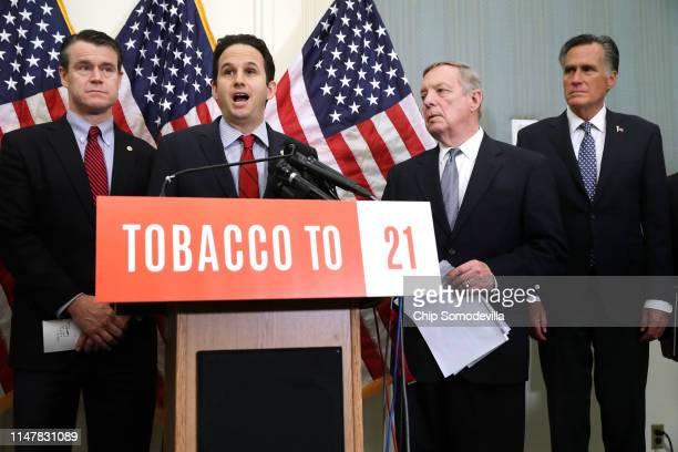 Sen Todd Young Sen Brian Schatz Sen Richard Durbin and Sen Mitt Romney talk about their proposed Tobacco To 21 legislation during a news conference...