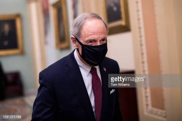 Sen. Tom Carper, D-Del., is seen in the Capitol during a break on the third day of the impeachment trial of former President Donald Trump on...
