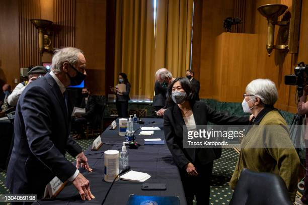 Sen. Tom Carper greets Katherine Tai, nominee for US Trade Representative and her mother at the Senate Finance Committee hearing at the US Capitol on...
