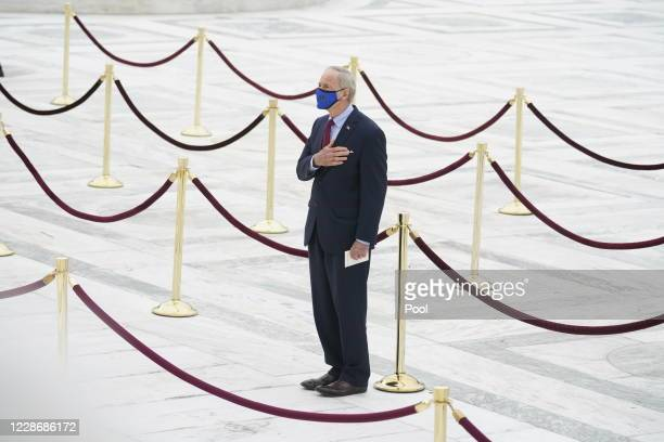 Sen. Tom Carper , pays respects as Justice Ruth Bader Ginsburg lies in repose under the Portico at the top of the front steps of the U.S. Supreme...