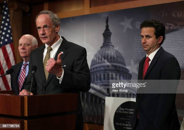 Sen. Tom Carper speaks as Sen. Ben Cardin and Sen. Brian Schatz listen during a news conference at the Capitol May 24, 2017 in Washington, DC. Senate...