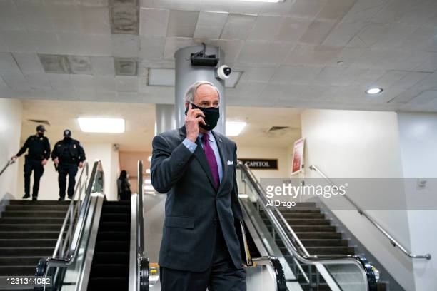 Sen. Tom Carper speaks on a mobile phone as he departs following a vote in the subway of the U.S. Capitol on February 23, 2021 in Washington, DC. The...