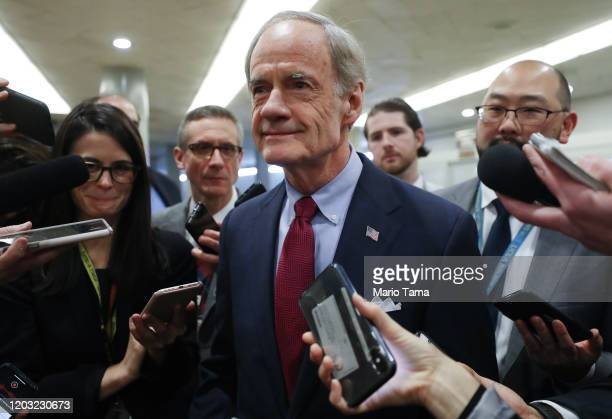 Sen. Tom Carper speaks to reporters as he arrives at the U.S. Capitol as the Senate impeachment trial of U.S. President Donald Trump continues on...