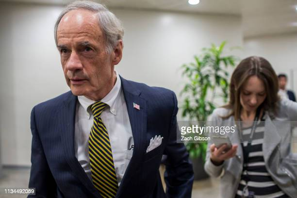 Sen. Tom Carper speaks to reporters in the Senate basement before a weekly policy luncheon on April 2, 2019 in Washington, DC.