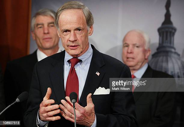 Sen. Tom Carper , speaks while flanked by U.S. Sen. John McCain , and U.S. Sen. Mark Udall , during a news conference about a proposed line-item...
