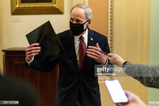 Sen. Tom Carper speaks with reporters on the Senate Side of the U.S. Capitol Building on Thursday, Feb. 11, 2021 in Washington, DC. The third day of...