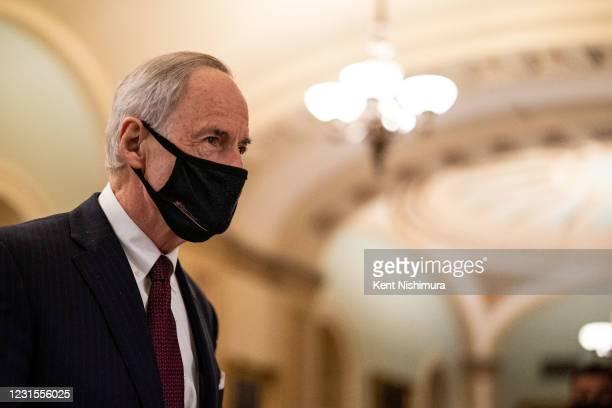 Sen. Tom Carper walks on the senate side of the Capitol building on Saturday, March 6, 2021 in Washington, DC. The Senate passed a landmark...