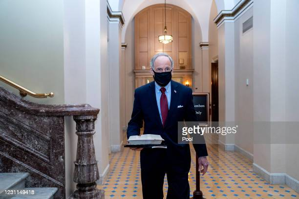 Sen. Tom Carper wears a protective mask while departing the U.S. Capitol on February 13, 2021 in Washington, D.C. Former President Donald Trump's...