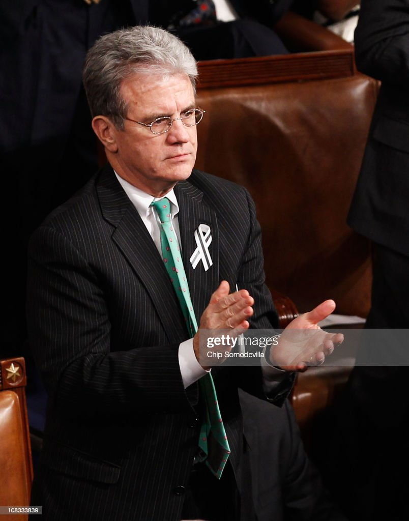 Sen. Tom Coburn (R-OK) applauds as U.S. President Barack Obama addresses a Joint Session of Congress while delivering his State of the Union speech January 25, 2011 in Washington, DC. During his speech Obama was expected to focus on the U.S. economy and increasing education and infrastructure funding while proposing a three-year partial freeze of domestic programs and $78 billion in military spending cuts.