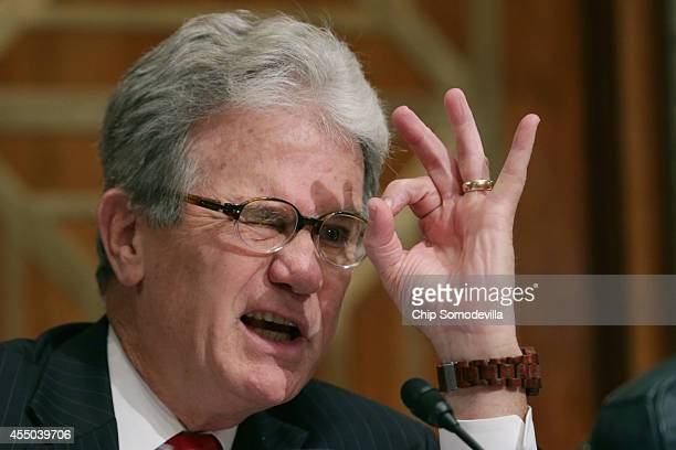 Sen. Tom Coburn forms a circle with his fingers while asking witnesses about 30mm calibre ammunition that has been given to local law enforcement...