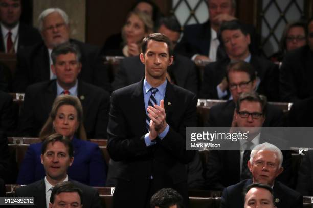 S Sen Tom Cotton applauds during the State of the Union address in the chamber of the US House of Representatives January 30 2018 in Washington DC...