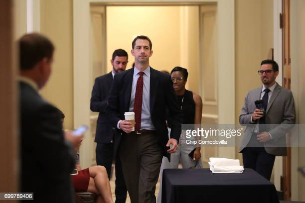 Sen Tom Cotton heads back into a meeting of GOP senators in the US Capitol June 22 2017 in Washington DC Most Republican senators were given their...