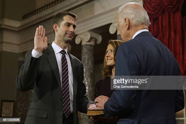 Sen Tom Cotton is ceremonially sworn in by Vice President Joe Biden in the Old Senate Chamber with Cotton's wife Anna Cotton at the US Capitol...