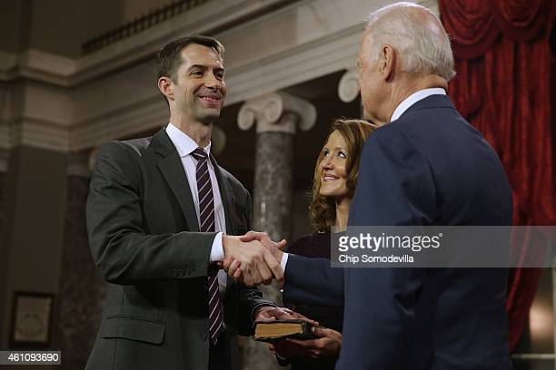 Sen Tom Cotton is congratulated by Vice President Joe Biden during a ceremonial swearing in at the Old Senate Chamber with Cotton's wife Anna Cotton...