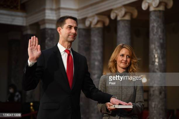 Sen. Tom Cotton, R-Ark., participates in a mock swearing-in for the 117th Congress with Vice President Mike Pence, as his wife Anna Peckham holds a...