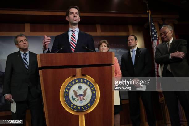 Sen. Tom Cotton speaks as Sen. Sherrod Brown , Sen. Jeanne Shaheen , Sen. Marco Rubio and Senate Minority Leader Sen. Chuck Schumer listen during a...