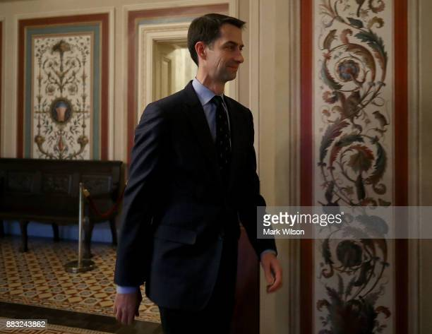 Sen Tom Cotton walks to a vote in the Senate Chamber on Capitol Hill November 30 2017 in Washington DC Senate Republicans are poised to pass sweeping...