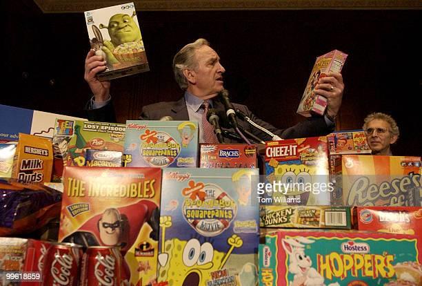 Sen Tom Harkin DIowa holds up sugar laden cereal at a news conference announcing legislation to impose federal regulation of junk food marketing to...