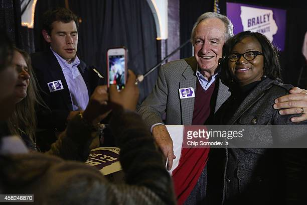 S Sen Tom Harkin poses for photographs with supporters during a fundraising event for Senate Democratic candidate Rep Bruce Braley at the Electric...