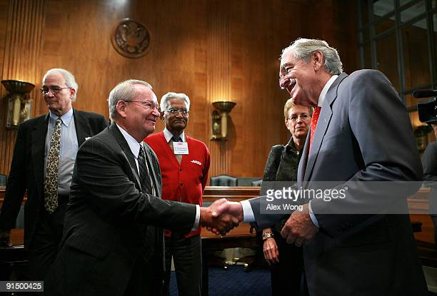 S Sen Tom Harkin shakes hands with Jack Gross plaintiff of the Supreme Court Gross v FBL Financial case after a news conference on Capitol Hill...
