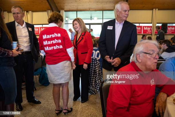 Sen Tom Tillis looks on as US Rep Marsha Blackburn Republican candidate for US Senate talks with supporters during a getoutthevote rally at Henry...