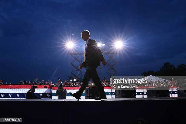 """Sen. Tommy Tuberville leaves the stage after addressing a """"Save America"""" rally where the keynote speaker was former President Donald Trump at York..."""
