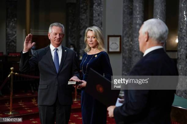 Sen. Tommy Tuberville , the former Auburn University football coach, joined by his wife Suzanne Tuberville, arrives to take the oath of office from...