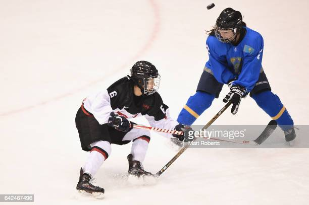 Sena Suzuki of Japan and Aida Olzhabayeva battle for the puck during the Women's Ice Hockey match between Kazakhstan and Japan on the day one of the...